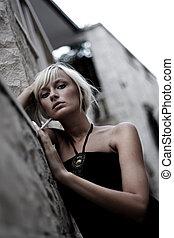 Young beautiful smoking woman.