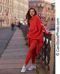 sporty stylish woman in red outfit