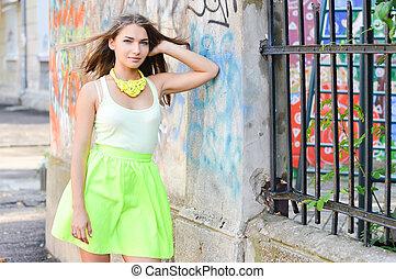 Young beautiful stylish woman street fashion