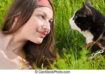 Young beautiful teenage girl and her cat portrait - Young...