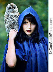 witch in the hood with an owl