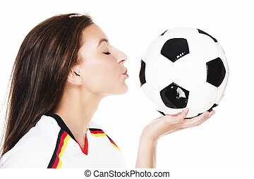 young beautiful woman about to kiss a football on white background