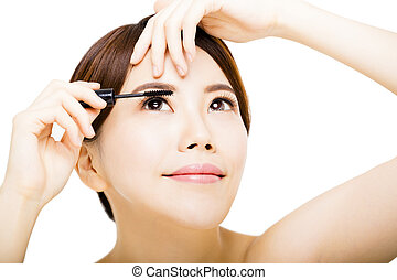 young beautiful woman Applying mascara isolated on white