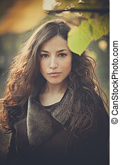 young beautiful woman autumn portrait in forest
