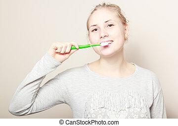 young beautiful woman brushing her