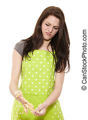 young beautiful woman cleaning her hands from dough on white background
