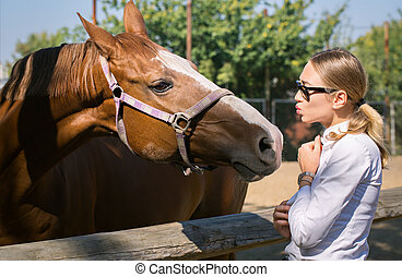 woman communicates with a horse