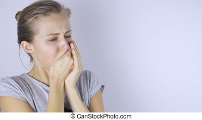 Young beautiful woman coughing
