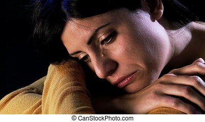 Young beautiful woman crying in the dark being abandoned by...