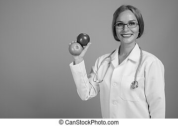 Young beautiful woman doctor with blond hair in black and white