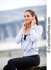 Young beautiful woman doing exercise on park