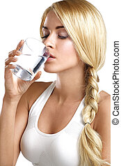 young beautiful woman drinking a glass of water