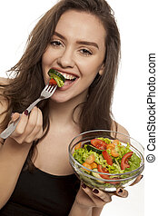 beautiful woman eating salad