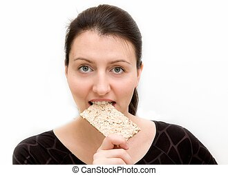 woman eats bread