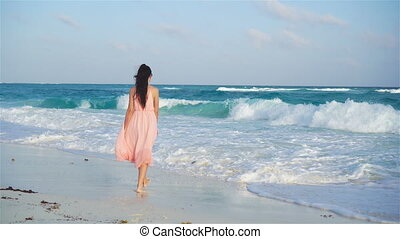 Young beautiful woman enjoy beach vacation