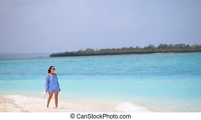 Young beautiful woman enjoying beach tropical vacation