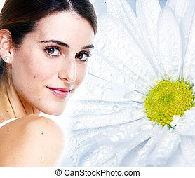 Young beautiful woman face.