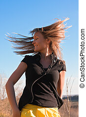 Young beautiful woman flapping her hair