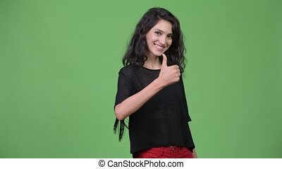 Young beautiful woman giving thumbs up