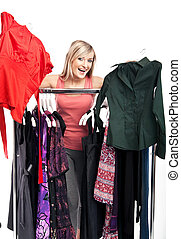 Young beautiful woman has a plenty of clothes to choose from