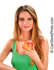 Young beautiful woman holding a red ripe apple in her hand