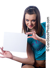 Young beautiful woman holding blank poster