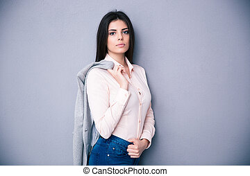Young beautiful woman holding jacket on a shoulder