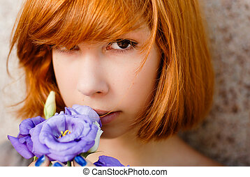 Young beautiful woman holding purple chinese rose