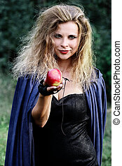 woman holds out her hand with an apple