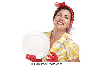Young beautiful woman housewife showing a magic wand on dishes