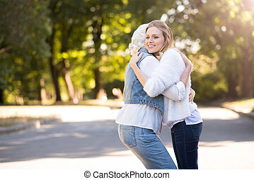 Young beautiful woman hugging her mother.