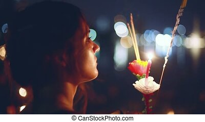 Young beautiful woman in a carnival to celebrate the Loy Krathong Festival. 1920x1080