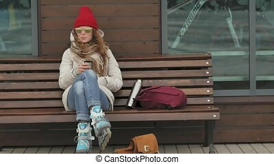 Young beautiful woman in a red hat wearing sporty warm...