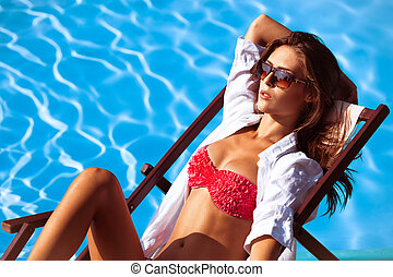 sunbath - young beautiful woman in bikini and sunglasses by ...