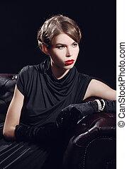 Young beautiful woman in black dress