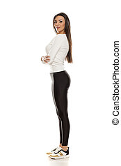 Young beautiful woman in black tights
