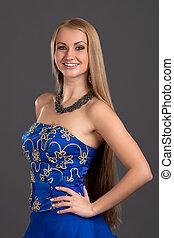Young beautiful woman in blue dress