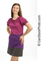 Young beautiful woman in dress posing