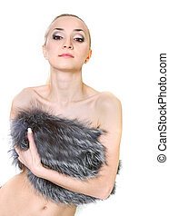 young beautiful woman in fur over white