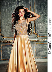 Young beautiful woman in gorgeous dress