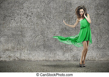 young beautiful woman in green dress on vintage grunge background