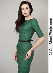 Young beautiful woman in green dress