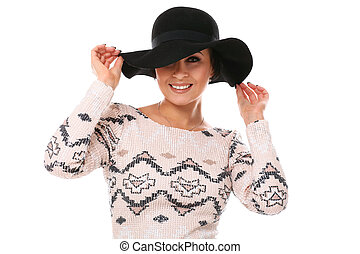Young beautiful woman in hat