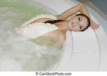 Young beautiful woman in jacuzzi