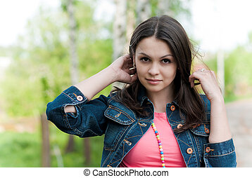 Young beautiful woman in jeans jacket outdoor portrait