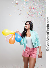 Young beautiful woman in party mood