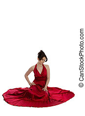 young beautiful woman in red evening dress sitting on floor