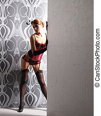 Young beautiful woman in retro style lingerie
