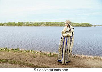 Young beautiful woman in Russian costume