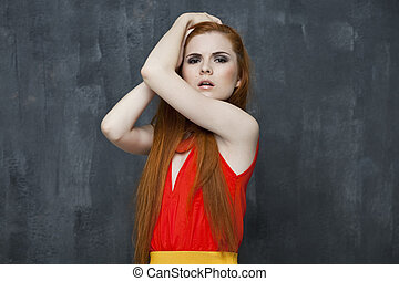 Young beautiful woman in studio